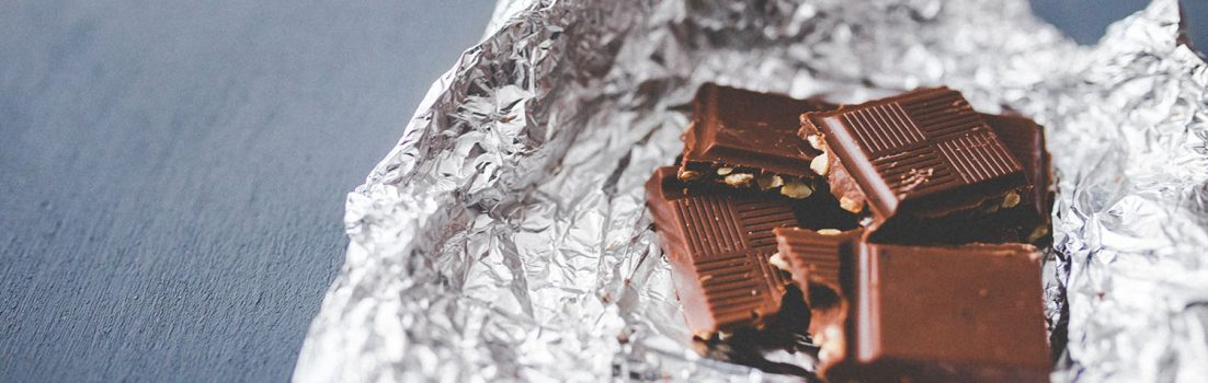 Squares of chocolate on silver foil