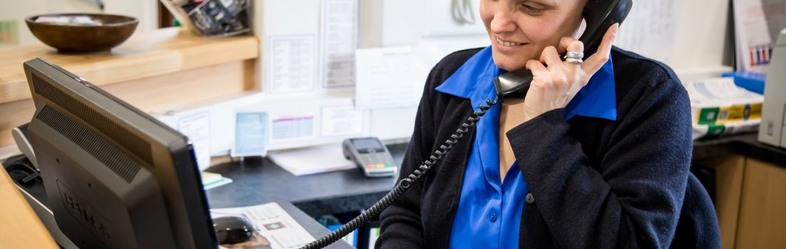 Image of a veterinary receptionist working