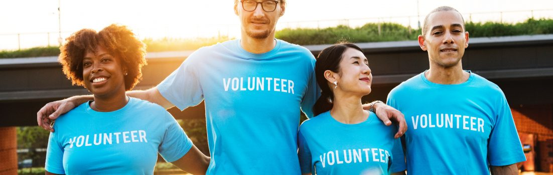 People wearing volunteering t shirts