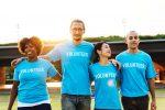 People wearing volunteering t shirts